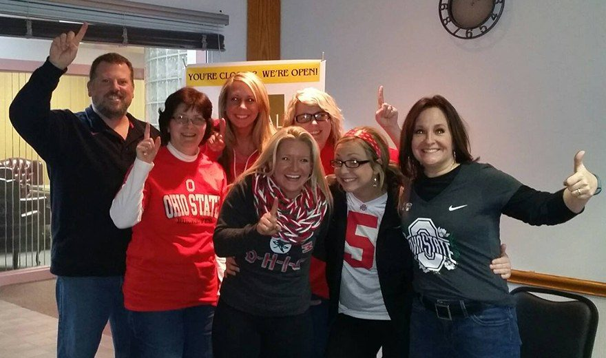 Team members wearing Ohio State gear