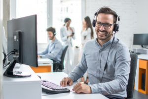Smiling male customer support specialist