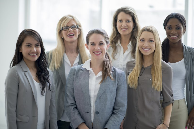 A group of businesswomen smiling.
