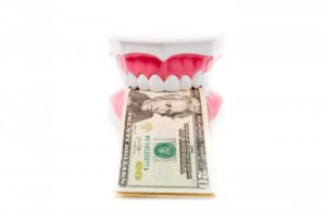 tooth model dollar bills