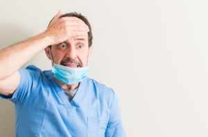 stressed dentist in need of dental insurance support