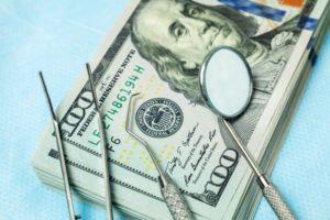 money, dental tools, and dental insurance verification