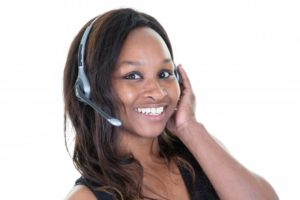 smiling woman working at a dental answering service