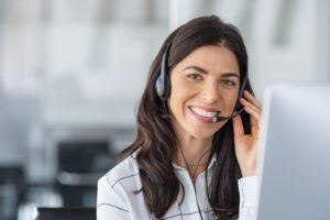 woman smiling at dental answering service