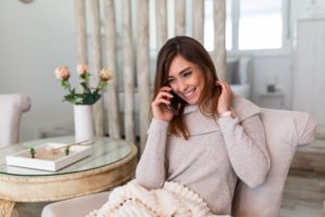 happy woman using a dental answering service