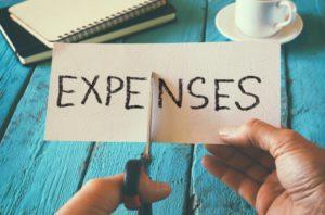 scissors cutting expenses paper