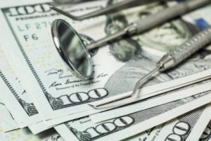 dental tools with money