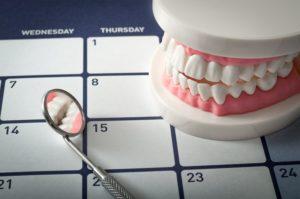 teeth and mirror on a calendar