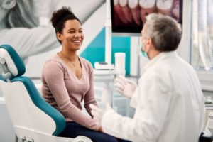 happy patient talking with the dentist after using dental answering service