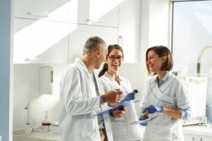 multiple dentists talking together