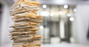 stack of printed files for chart auditing